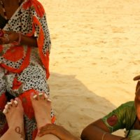 Goa India threading leg beach sun