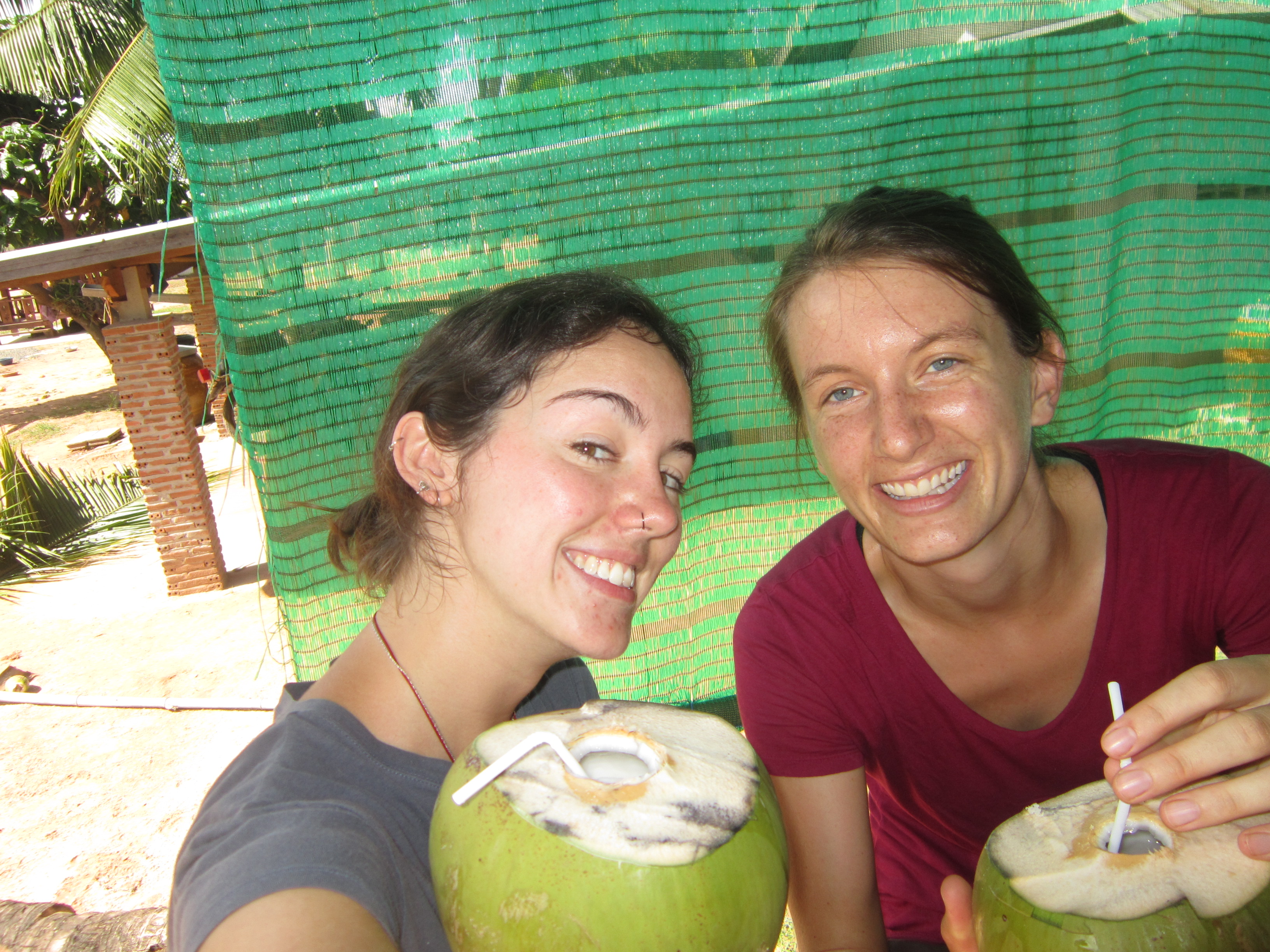 Drinking coconuts and laughing in Nong Weang, Thailand