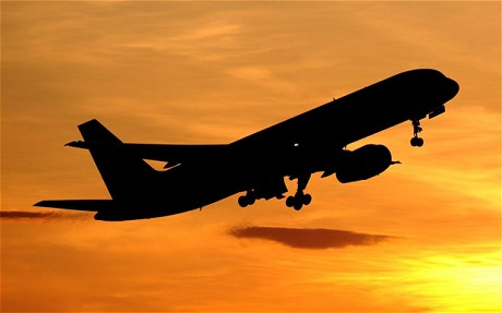 Plane sunset silhouette flying