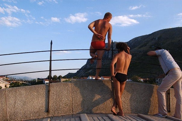 Mostar Bosnia bridge diver in red shorts