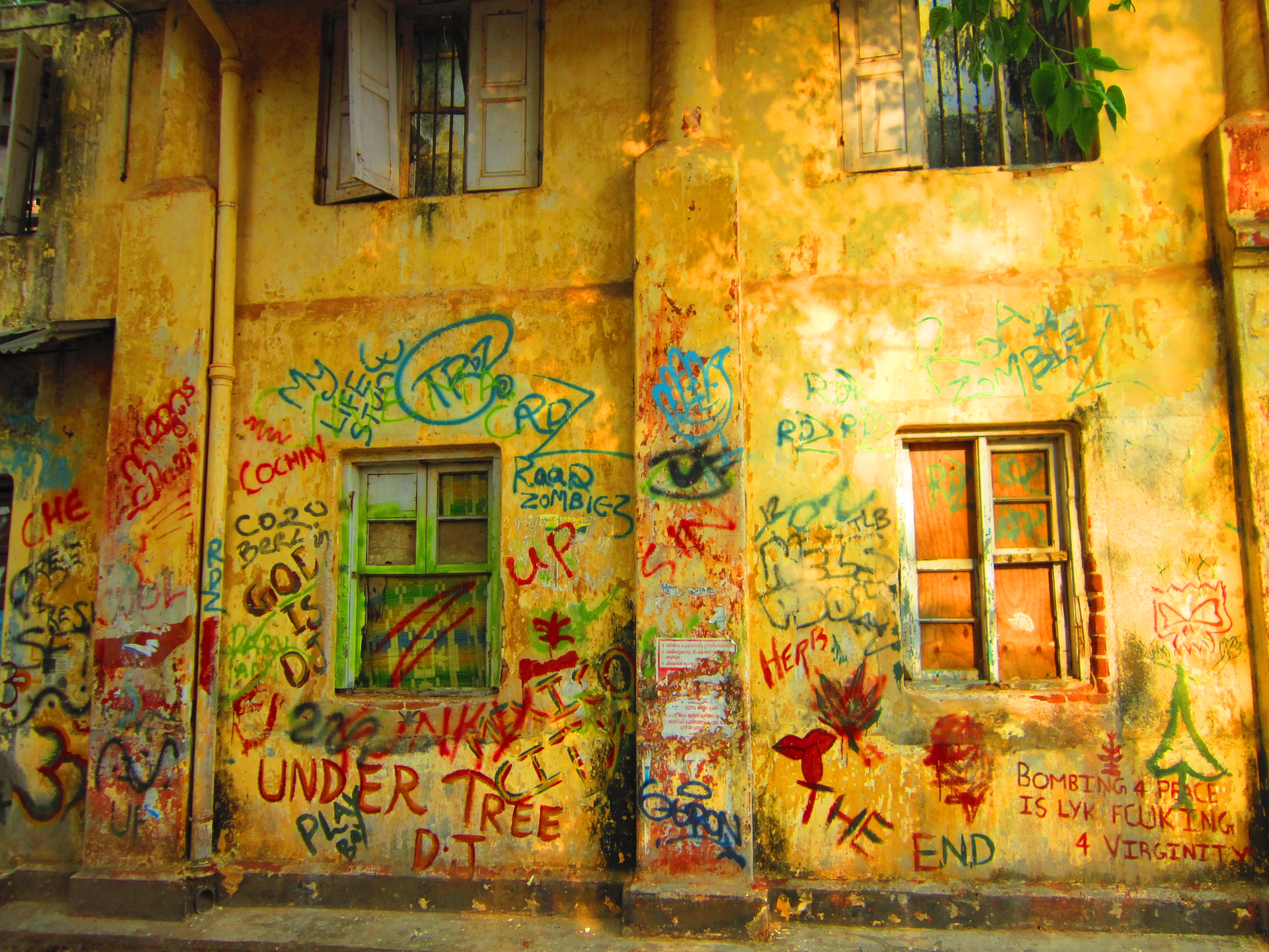 Kochi India yellow house with graffiti