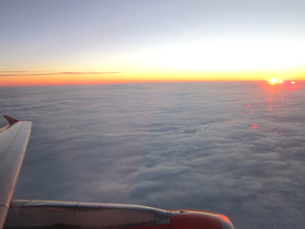 sunrise Easyjet plane flight clouds