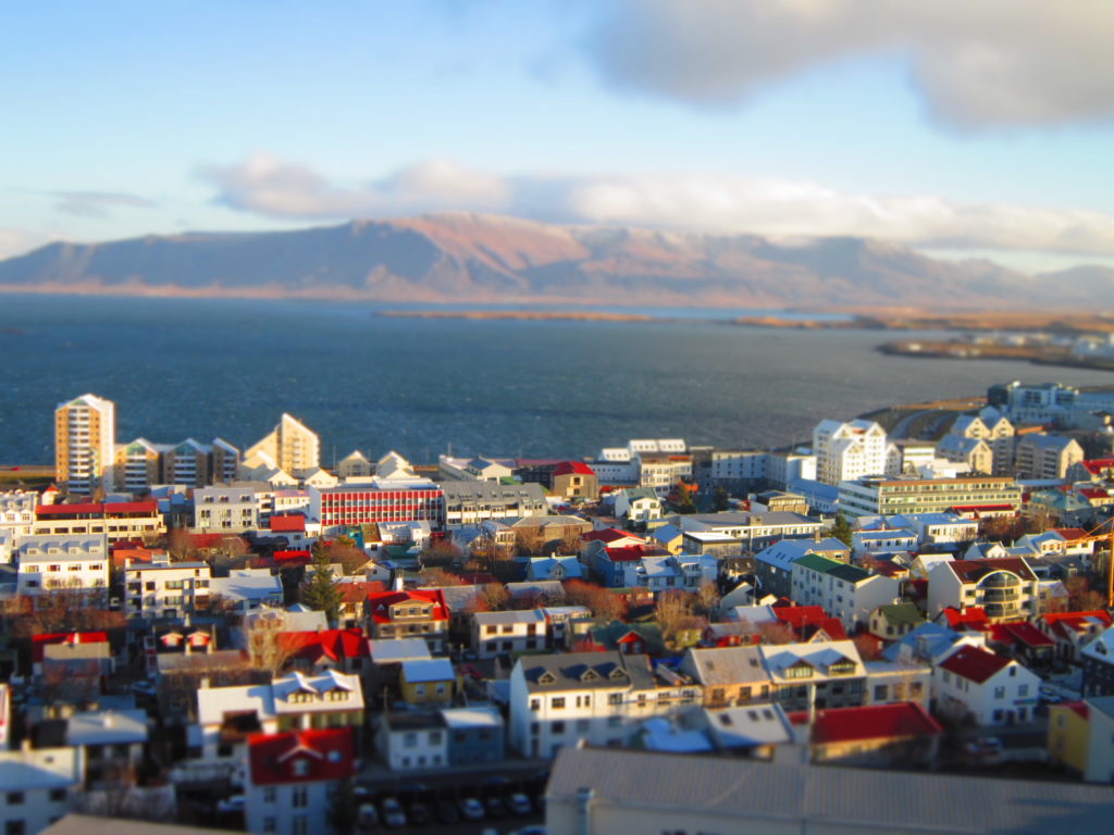 Reykjavik, Iceland birds eye view high mountains houses sea
